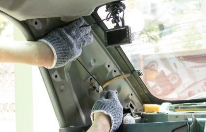 hands installing backup camera