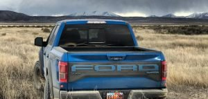 blue Ford F150 with battery inside