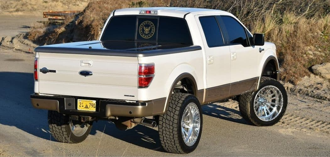 lifted white ford f150 with tonneau cover