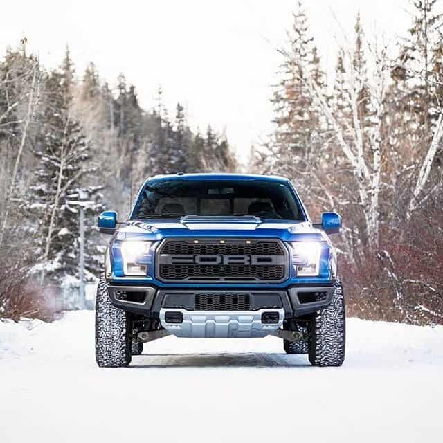blue ford ranger with shocks in snow background