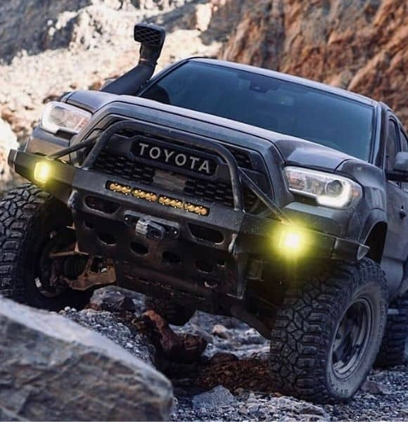 toyota black truck with shocks